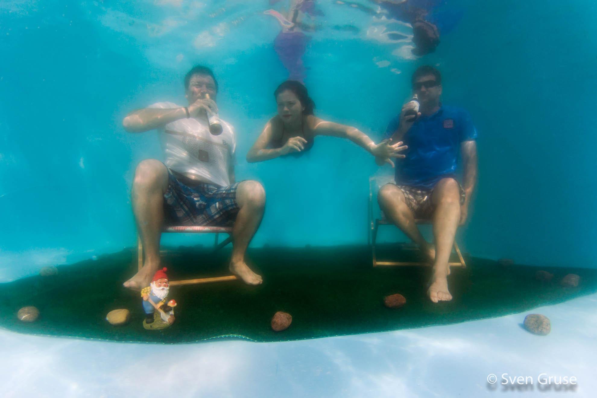 Familienfoto unter Wasser